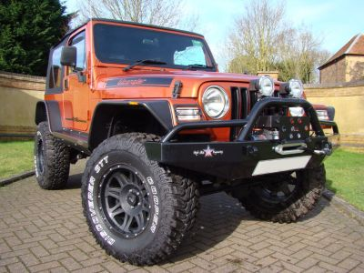 Jeep Wrangler 4.0 Grizzly 2dr Soft Top Convertible Petrol OrangeJeep Wrangler 4.0 Grizzly 2dr Soft Top Convertible Petrol Orange at Jeep Wranglers Leighton Buzzard