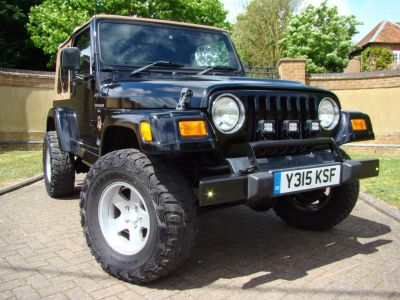 Jeep Wrangler 4.0L Sahara Soft Top Four Wheel Drive Petrol BlackJeep Wrangler 4.0L Sahara Soft Top Four Wheel Drive Petrol Black at Jeep Wranglers Leighton Buzzard